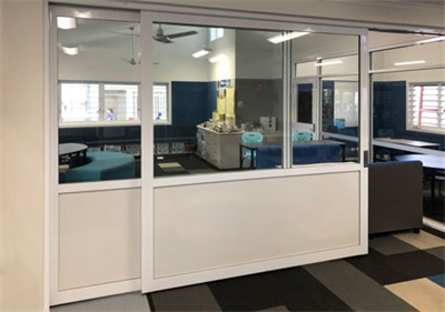 Cavity Sliders with whiteboard and glass doors for primary school