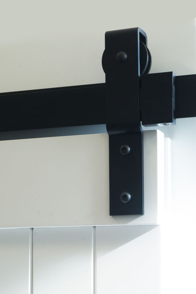 Barn door hanger bracket